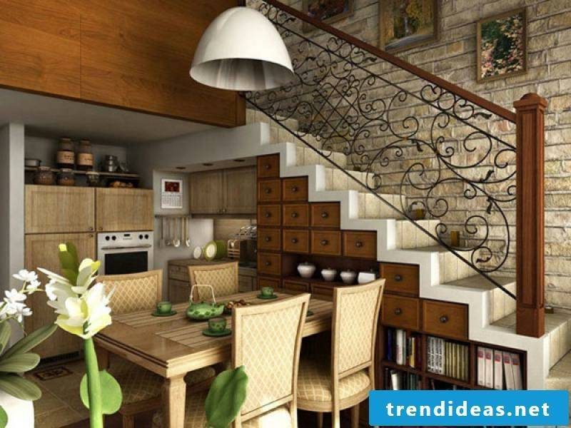 small wooden kitchen under the stairs