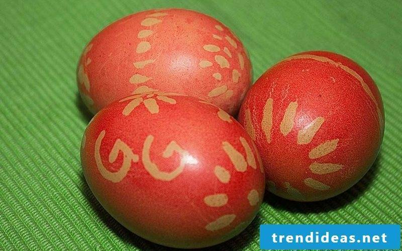 Easter eggs color with natural colors. Red pattern. Lemon juice