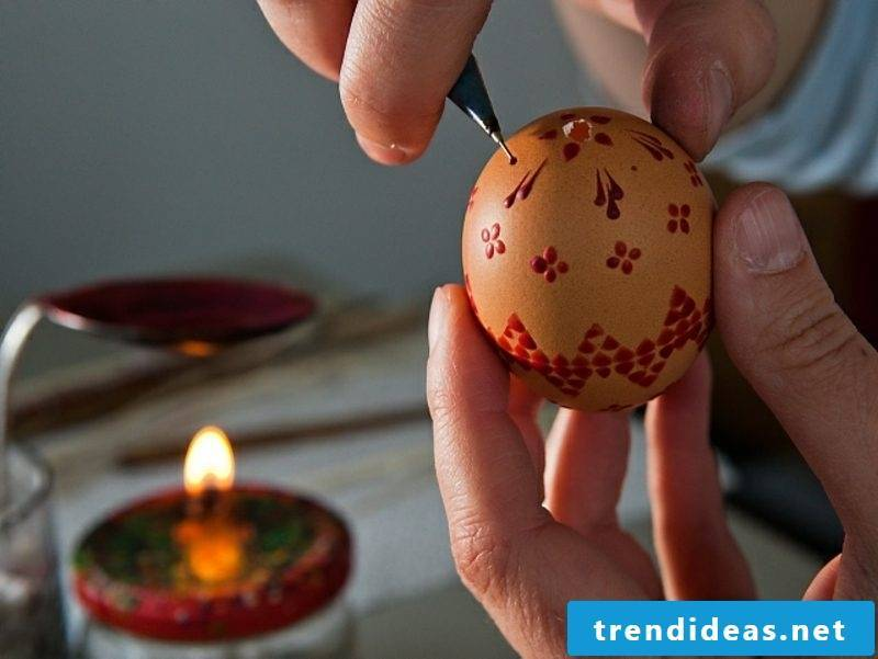 Color eggs and decorate with wax