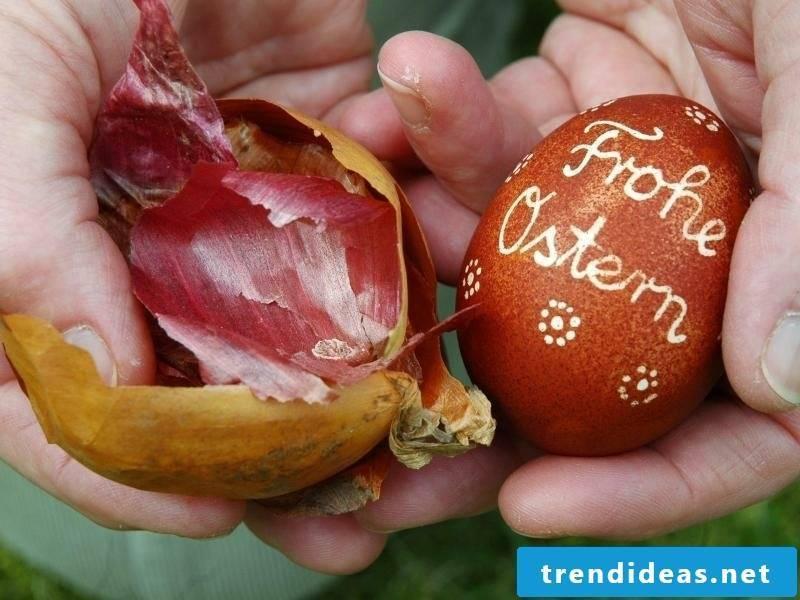 Egg with onion peels color pattern. Lemon juice