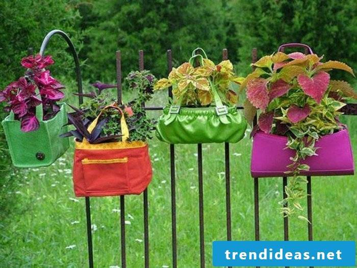 old bags with flowers in the garden