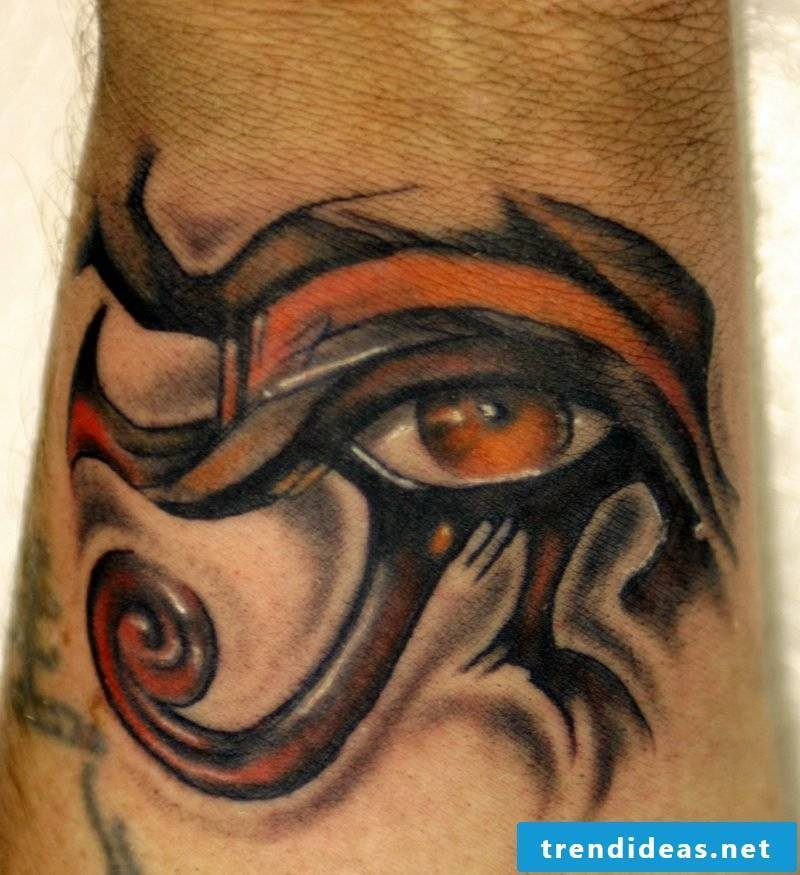 Horus eye orange color tattoo