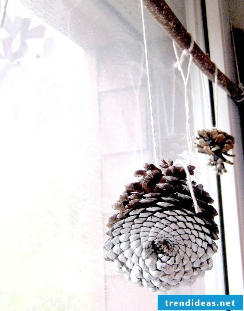 Tinker with pinecone window decoration