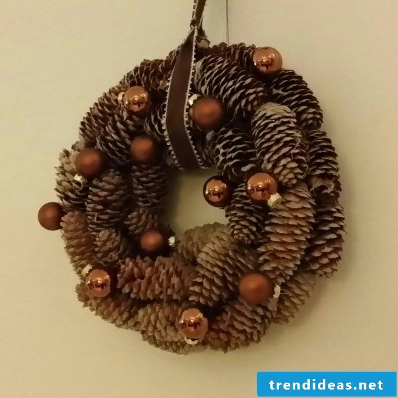 Tinker with pinecone wreath