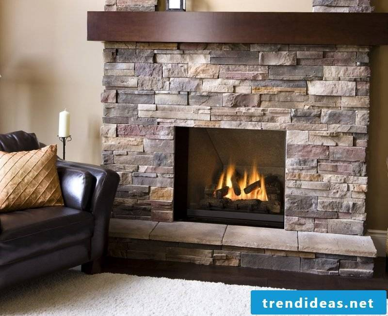 Fireplace cladding - combination of natural stones and wood