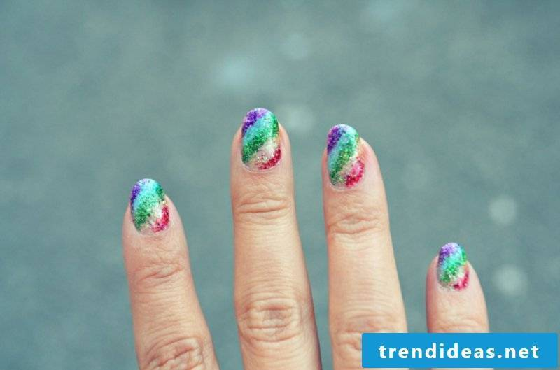 Gel nails with glitter rainbow colors