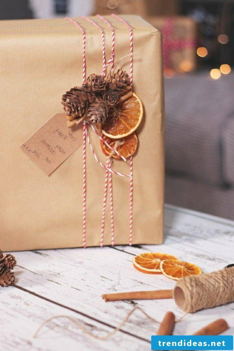 Gifts wrap dried orange pine cones