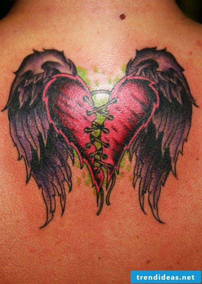Heart tattoo broken heart with wings