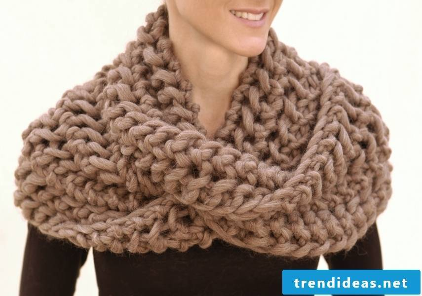 A women's scarf can spice up your winter outfit.