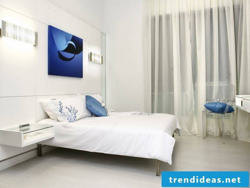 bedroom with a blue picture