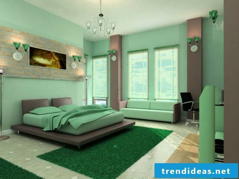 a big picture for a green bedroom