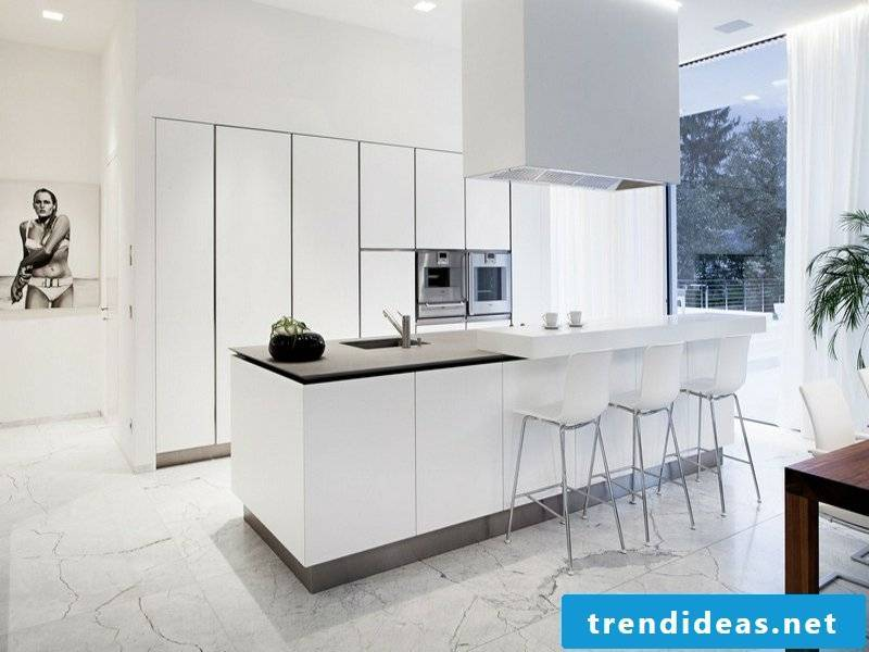 white marble tiles next to the kitchen island
