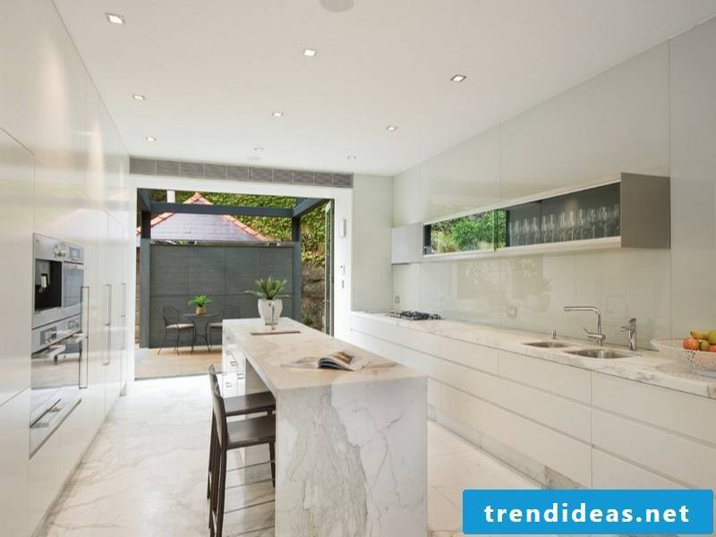 beautiful white cooking island with marble tiles