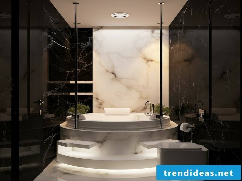 freestanding bathtub on marble tiles