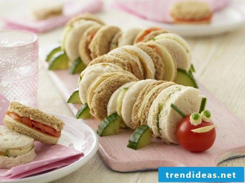 Child's birthday eating caterpillar made from sandwiches