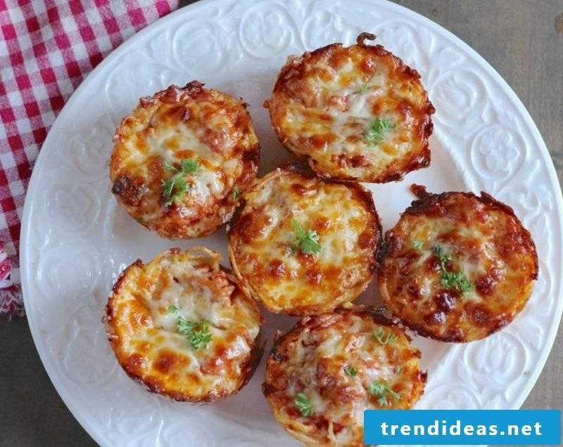 Child Birthday Baking appetizers with spaghetti, eggs and Parmesan