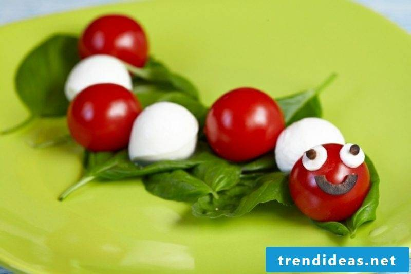 Fingerfood Kids Birthday funny caterpillar made of tomatoes and mozarella