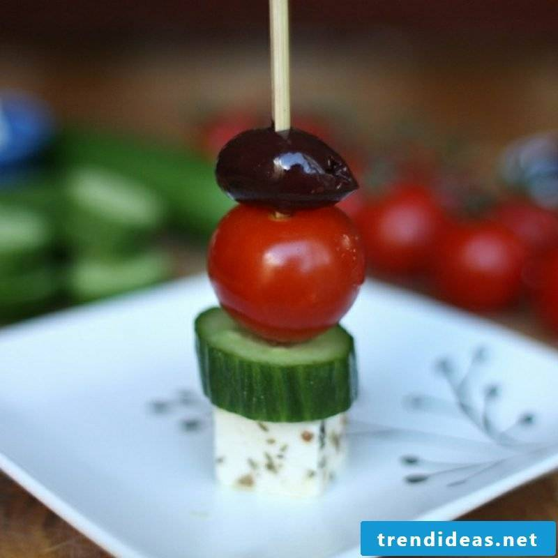 Vegetables Children's birthday skewers with tomatoes, cucumbers, olives and mozarella