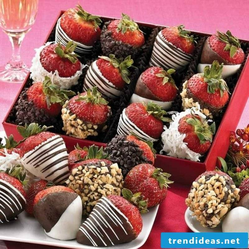 Eating kids birthday strawberries, dipped in chocolate