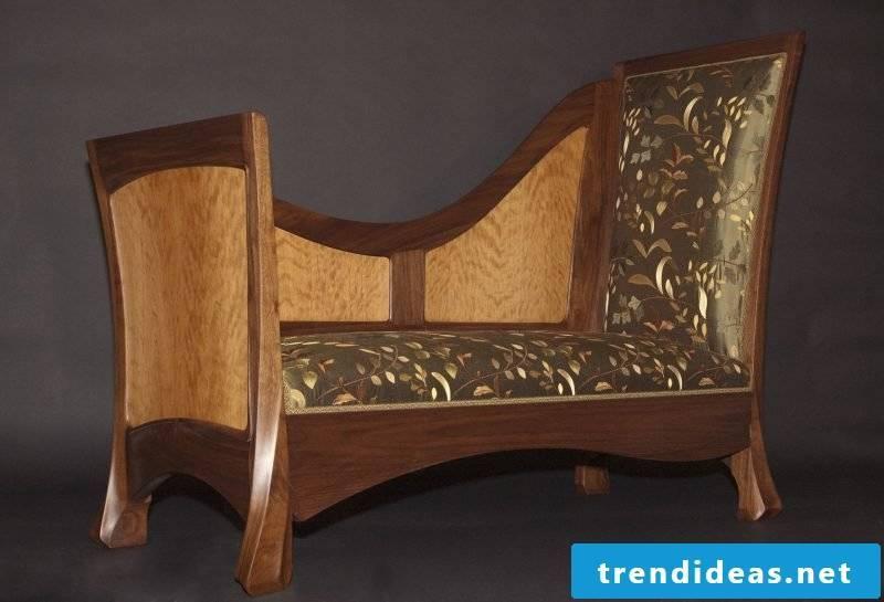 Art Nouveau features wooden sofa