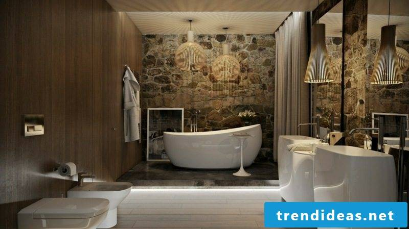 Luxury bathroom accent wall natural stone cladding large porcelain bathtub indirect accent lighting