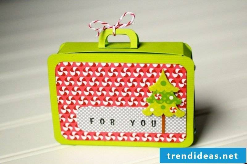 Make a gift coupon as a travel suitcase