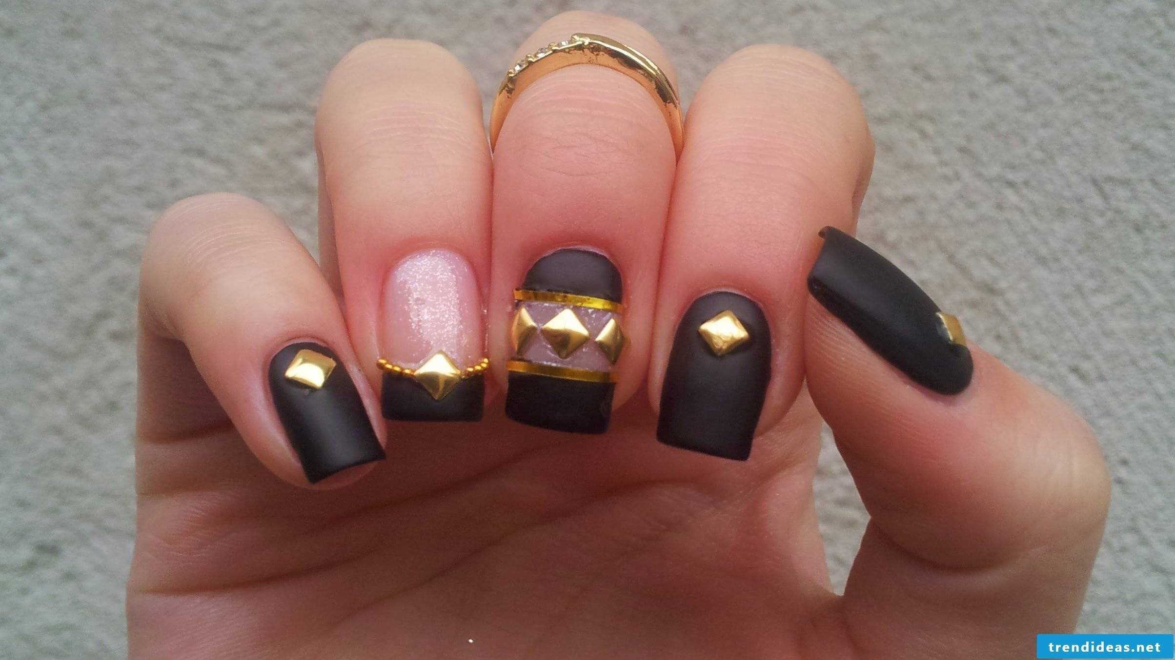 Beautiful nails with gold elements