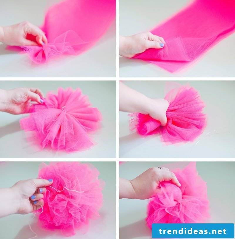 Make pompoms out of tissue paper