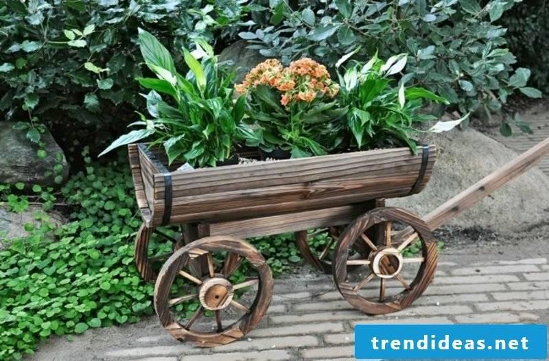 Fancy garden decor itself make wheelbarrow flowers