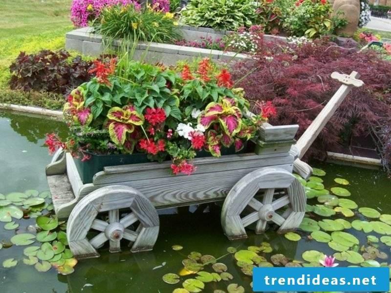 Fancy garden decoration make wheelbarrow yourself