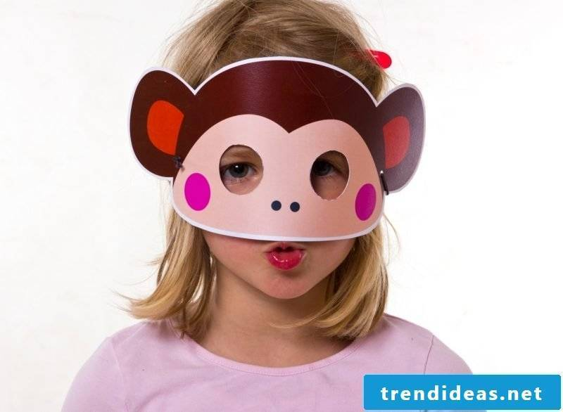 Animal masks make little sweet monkeys on a girl's face