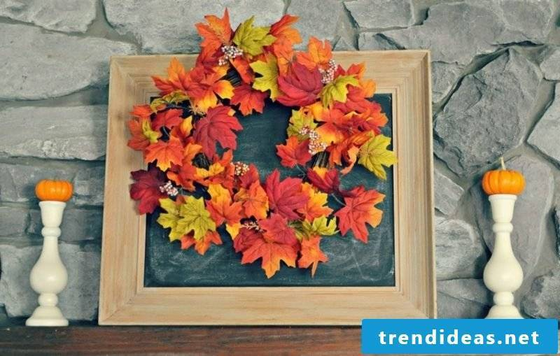 Autumn decoration wreath of colorful leaves