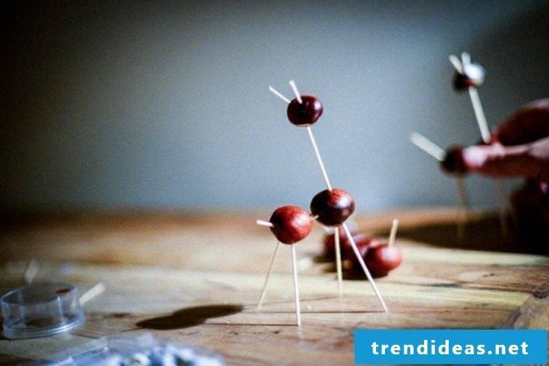 Autumn tinker with children chestnuts