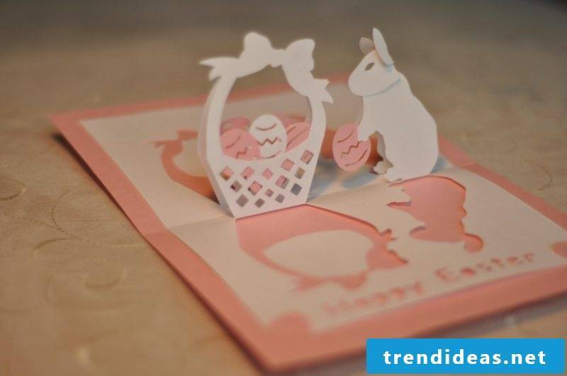 Cutting Easter cards with a print template in the shape of the rabbit