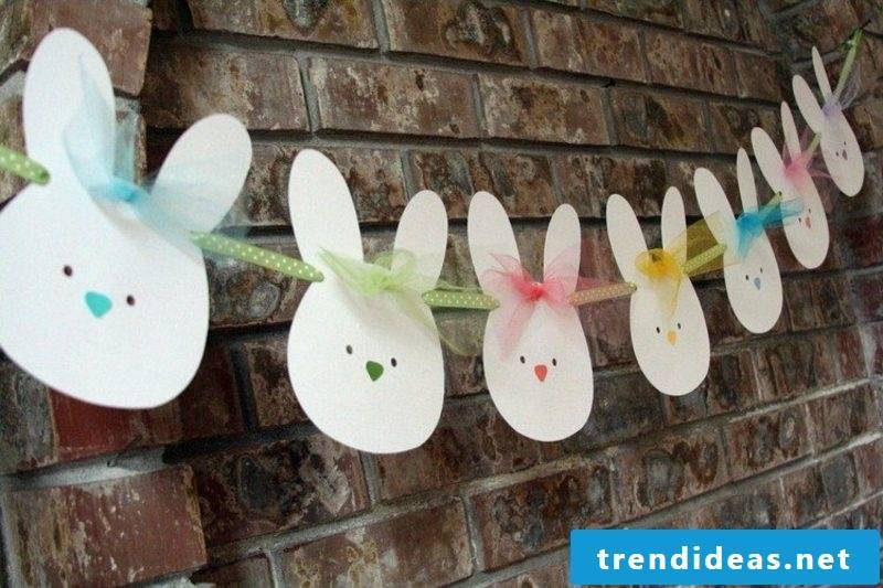 funny Easter bunnies made of paper craft garland
