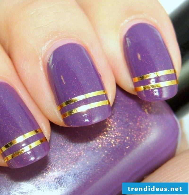 purple fingernails with golden trim