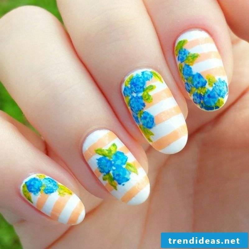 Flowers and stripes original motifs spring nail art design