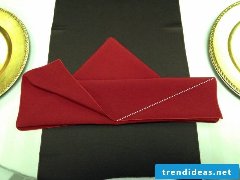 Fold napkins for Christmas at the right corner