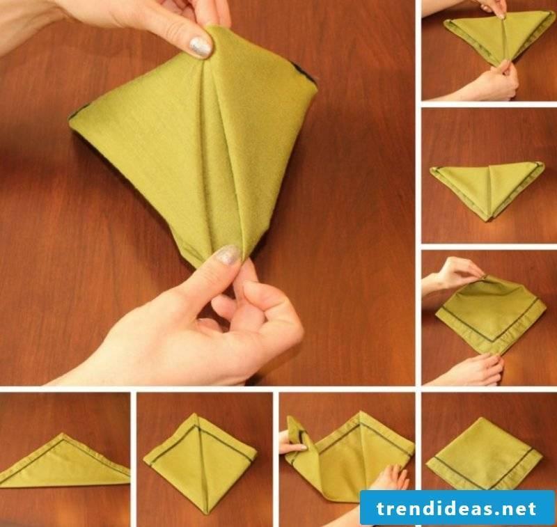 Napkins are folding at Christmas pyramid