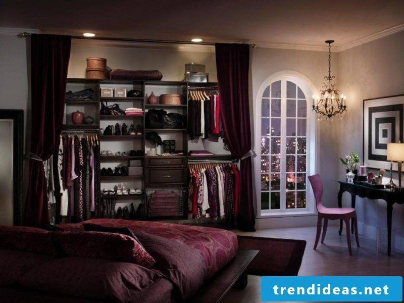 walk-in wardrobe bedroom window clothes rack clothes jackets shoes chair light
