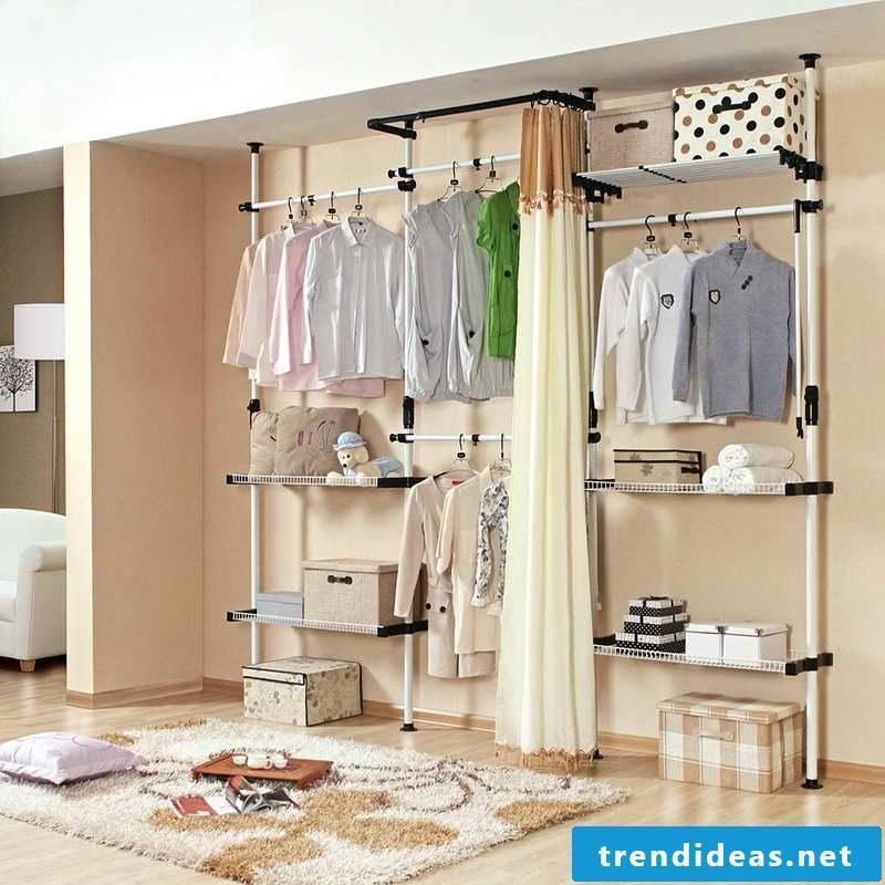 open wardrobe shelving white carpet curtains
