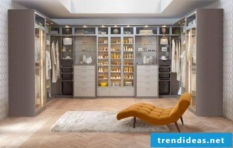 dressing room furnishings walk-in wardrobe armchair carpet furniture garments shelf systems