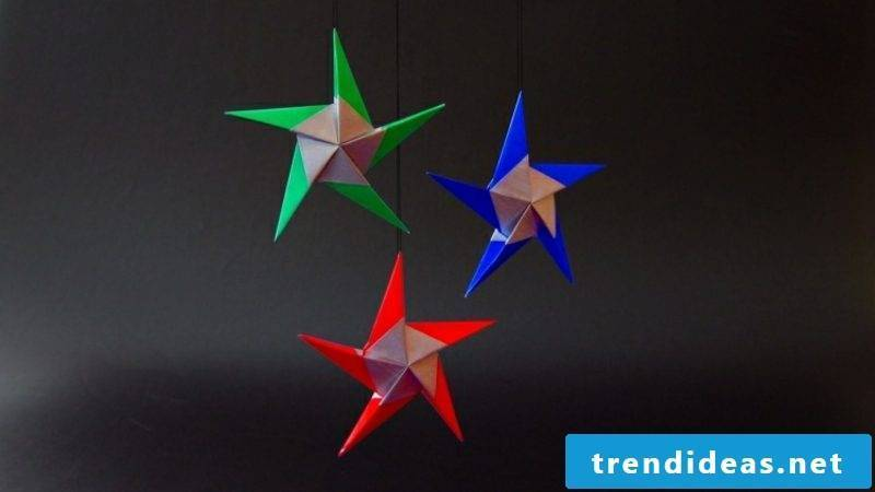 Origami Christmas great stars made of glossy paper