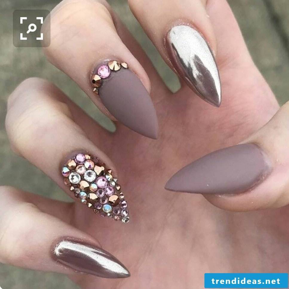 Top nails varnish with stone decorations