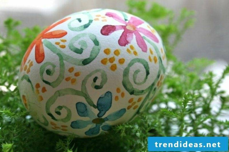 Easter eggs painted with kids watercolor floral pattern