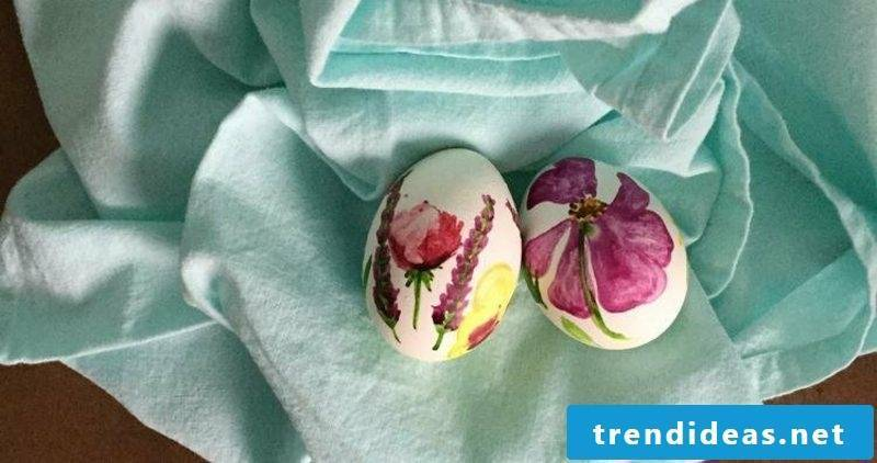 Easter eggs painted with children's watercolor instructions