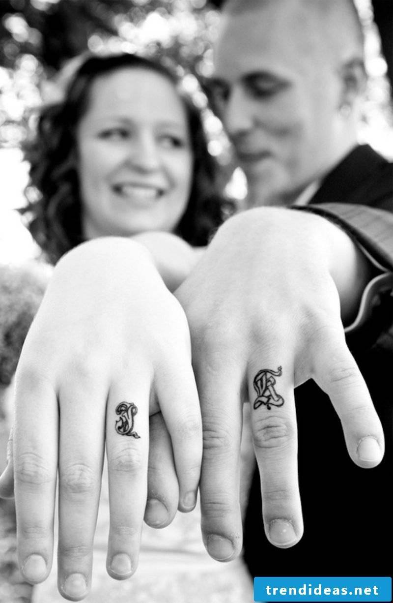 Partner tattoos initial instead of wedding rings