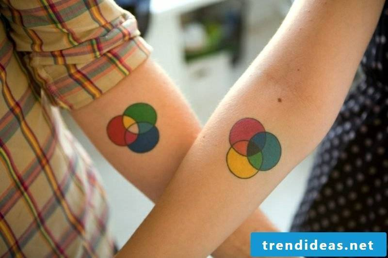 Partner tattoos color circles forearm