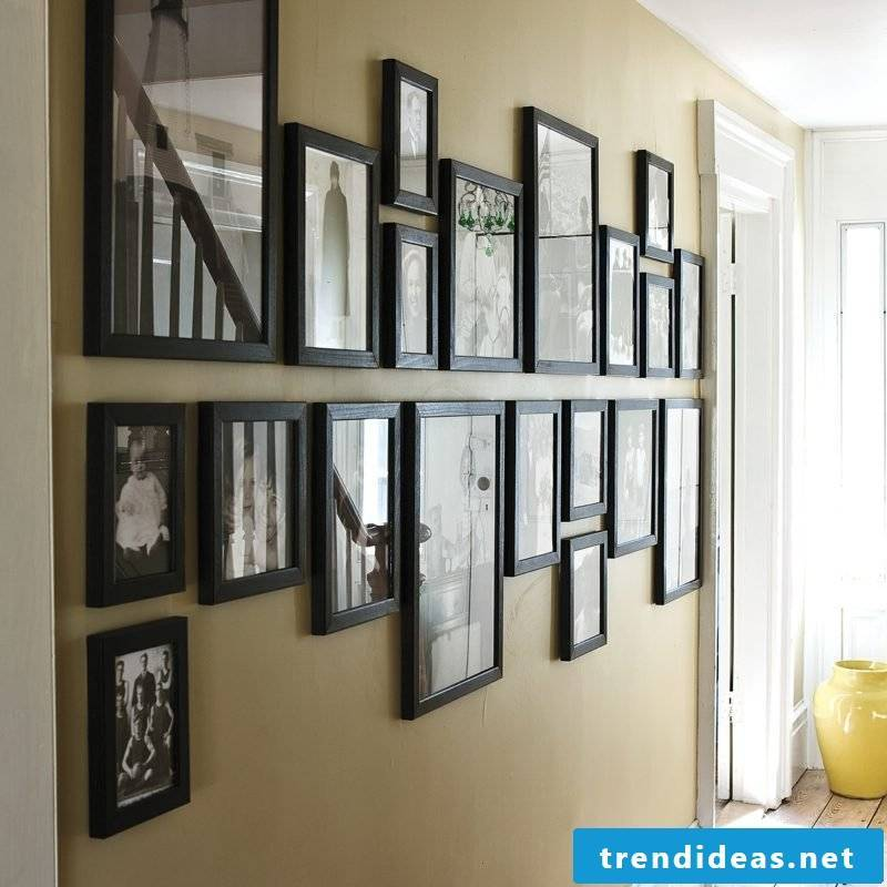 photo wall in the corridor symmetrical picture frame arrangement