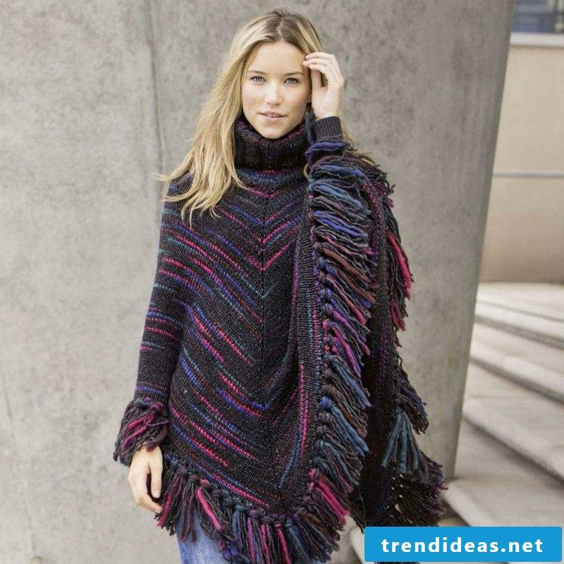 Poncho itself knit with fringes